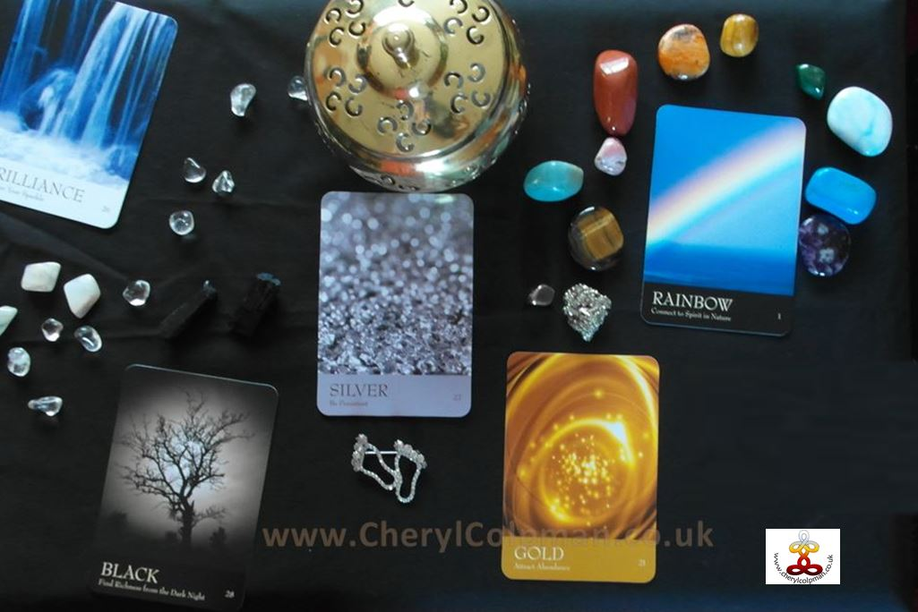 Meditation focus table with crystals and The Secret Language of Color cards Inna Segal meditation with Cheryl Colpman