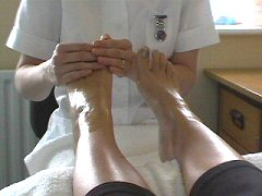 reflexology view from the client practitioner hands on feet cherylcolpman.co.uk