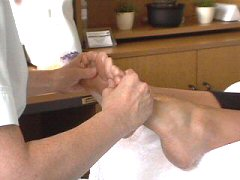 reflexology practitioner's hands on feet side view cherylcolpman.co.uk
