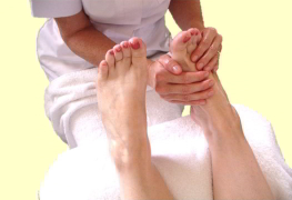 reflexology treatment showing practitioner's hands on feet gentle touch reflexology cherylcolpman.co.uk